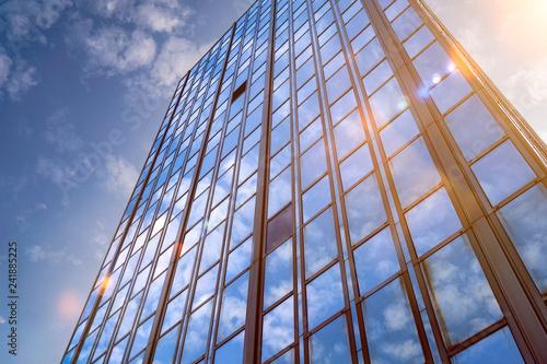 Leinwanddruck Bild Hochhaus Wolkenkratzer mit Gegenlicht