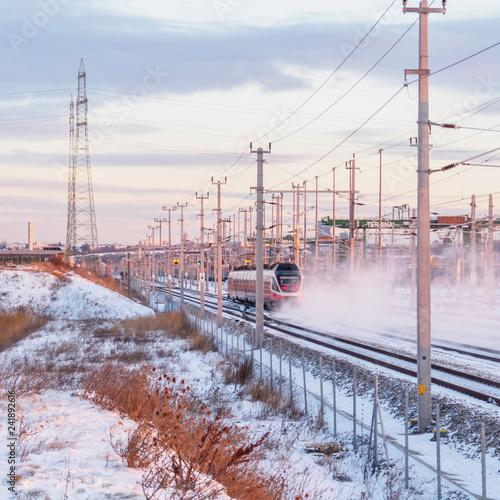 Train in winter drives through