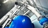 Large industrial water treatment and boiler room. Piping, armature, pressure vessels - 241899479