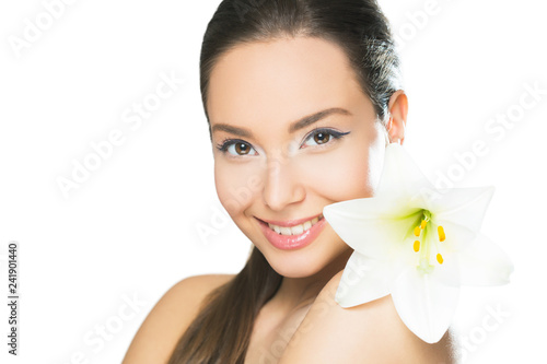 Young brunette beauty with flower.
