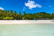 Amazing tropical beach on the island Malcapuya. Beautiful tropical island with white sand and palm trees. Palawan, Philippines.