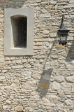 Fragment of the ancient castle with street lamp  and a window. - 241908870