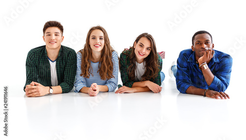 Leinwandbild Motiv group of cheerful young people men and women isolated on white background