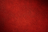 texture of red natural leather closeup with dimming - 241913233