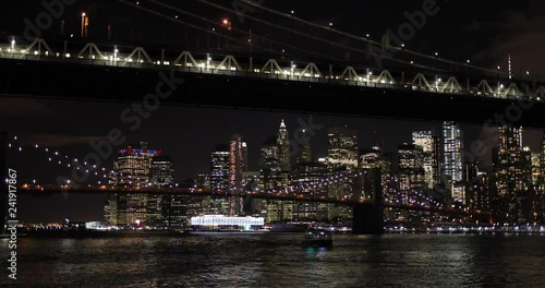 New York City downtown buildings night skyline boat sailing