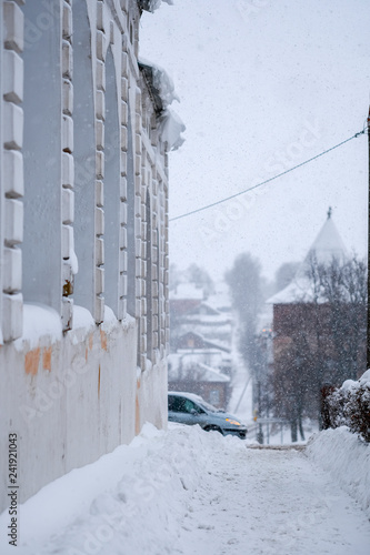 Russia, Zaraysk - January, 4, 2019: the image of cars on the parking near the building in the city of Zaraysk in snowfall