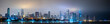 Long panoramic view of Chicago skyline at night with top of the buildings covered in fog