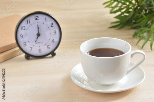 A cup of coffee on a wood table  - 241932013