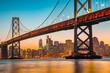 Leinwandbild Motiv San Francisco skyline with Oakland Bay Bridge at sunset, California, USA
