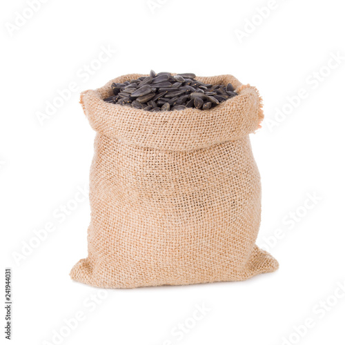 a black sunflower seeds in a Burlap sack bag isolated on white background