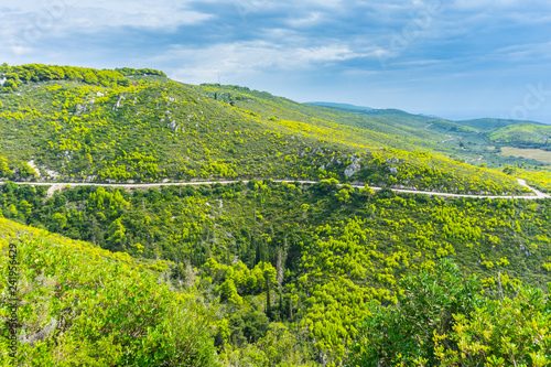 Greece, Zakynthos, Curved mountain road through green paradise like mountains and valleys