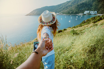 Asian lover couple woman and man travel nature. Travel relax. sea In the summer. Promthep Cape, Phuket Thailand.