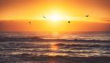 Fototapeta Zachód słońca - Beautiful sunrise over the sea © ValentinValkov
