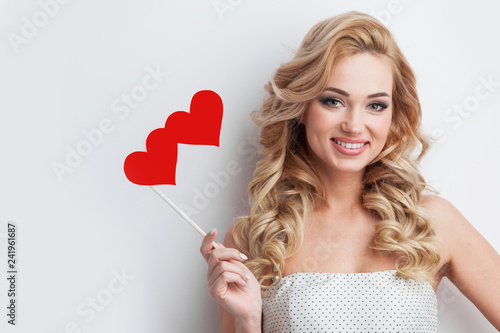 Positive girl holds red hearts - 241961687