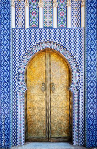 Entrance door with mosaic and brass door at the Royal palace in Fes Morocco
