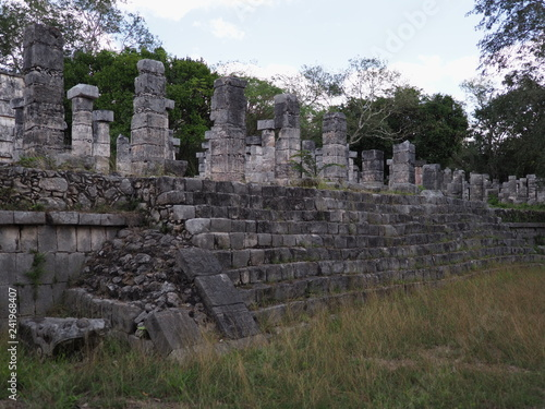 Fragment of stony platform of Temple of Warriors at Chichen Itza city in Mexico on February