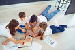 Top view of family drawing on the floor