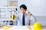 Young handsome architect working on the project  - 241983038