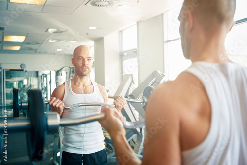 Bodybuilder man workout with dumbbells - 241987828