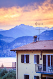 Beautiful evening scenery in the holidays: Apartment house, mountains and colourful sky