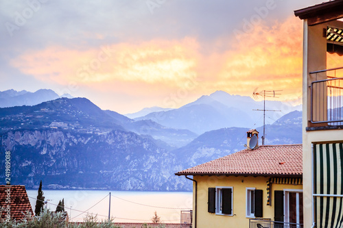 Beautiful evening scenery in the holidays: Apartment house, mountains and colourful sky - 241989088