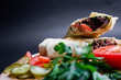 Shawarma sandwich with ingredients on dark background. Top view. sandwich in pita bread. burrito - 241990453
