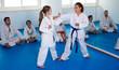 Leinwanddruck Bild - Girls training during karate class