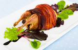 Photography of plate with baked in bacon quail with balsamic sauce