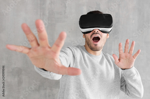 58e3b5c85ee Young man using VR headset