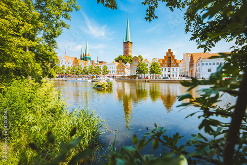 Leinwandbild Motiv Historic city of Lübeck with Trave river in summer, Schleswig-Holstein, Germany