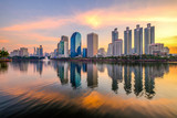 Business district cityscape from a park with sunrise time from Benchakitti park - 242014070