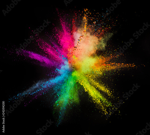 Foto Murales Explosion of colored powder on black background