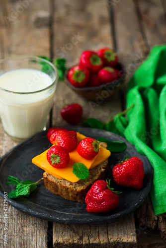 Cheese and strawberry sandwiches and soy milk.Healthy breakfast.