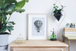 Leinwanddruck Bild - The room interior with mock up photo frame on the retro wooden shelf. Hanging plant in design pot, tropical plant, gold pyramid, design coffe table with books. Concept of minimalistic retro shelf.