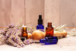 lavender mortar and pestle and bottles of essential oils for aromatherapy
