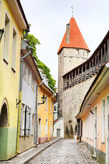 Muurivahe Street and Tower behind Monks in Old town, Tallinn, Estonia