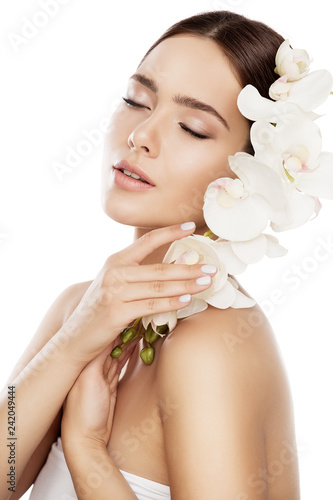 Leinwanddruck Bild Beauty Spa Skin Care, Woman Face Natural Makeup and Orchid Flower, Fashion Model Isolated over White Background