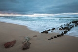 evening sea under a stormy sky, blurry water, long exposure - 242051437