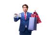 Leinwanddruck Bild - Elegant businessman with bags isolated on white