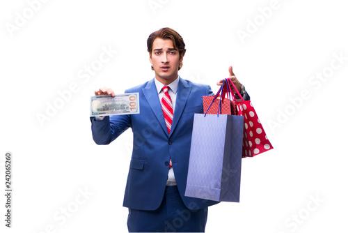 Leinwanddruck Bild Elegant businessman with bags isolated on white