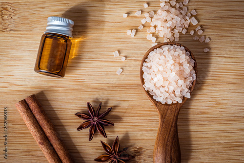 Close up brown organic Himalayan rock salt spa and cinnamon essential oil aroma set on table , healthy spa relaxation concept