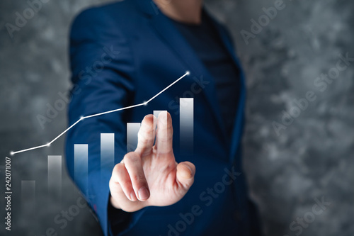 Poster businessman touching graph