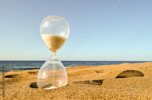 Hourglass Clock on the Sand Beach - 242071079