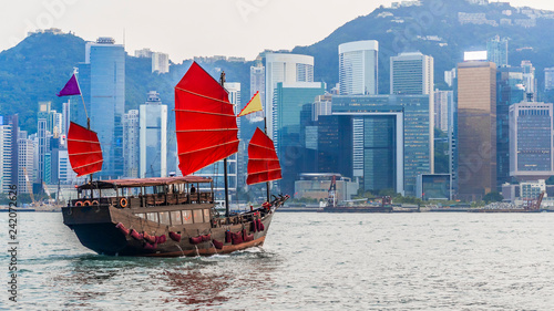 obraz PCV Hong Kong cityscape with tourist junk boat, View from Victoria harbour