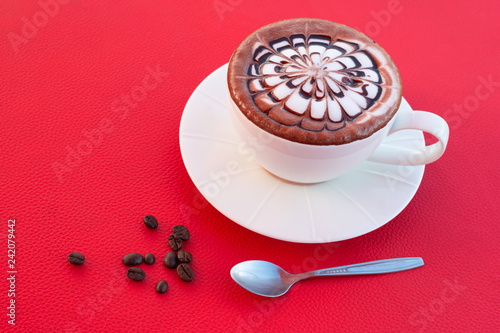 Coffee in a white coffee cup On red background