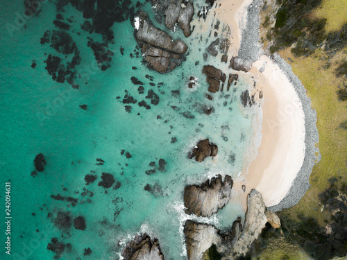 Aerial view of idyllic arc beach with pristine waters