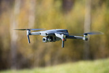 The drone copter flying with digital camera. - 242101431