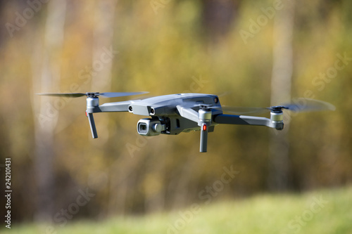 The drone copter flying with digital camera. © Pakhnyushchyy