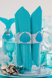 Aqua napkings with napkin rings for summer seaside party - 242108616