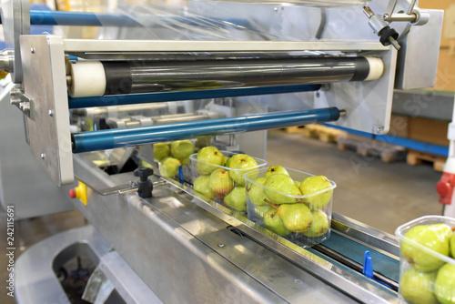 canvas print picture modern packaging machine for fresh pears in a factory for food industry // Verpackungsmaschine für Obst/ Birnen in Folie für den Verkauf im Supermarkt